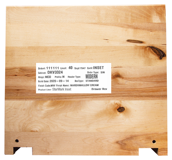 A label on the back of a StarMark Cabinetry drawer identifies the color and wood type of the cabinet.